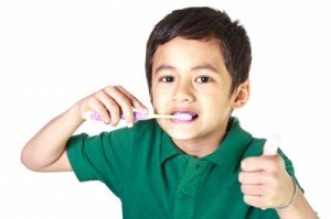 Child happily brushing his teeth